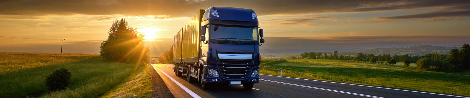 Delivery-Trucks-on-the-highway-morning-Stock-Photo-01